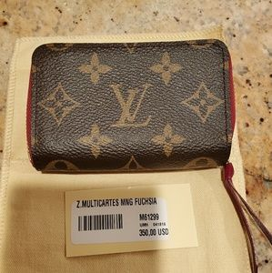 Louis Vuitton zippy multicartes fuschia
